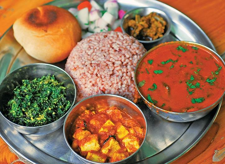 A sumptuous Veg Thali of Manali with mountain rice and pulses.
